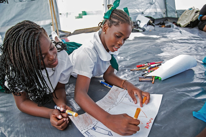 "Children in Anguilla drawing during a ""Return to Happiness"" session designed to help kids get back on track after Hurricanes Irma and Maria devastated the island territory and many of its neighbors."