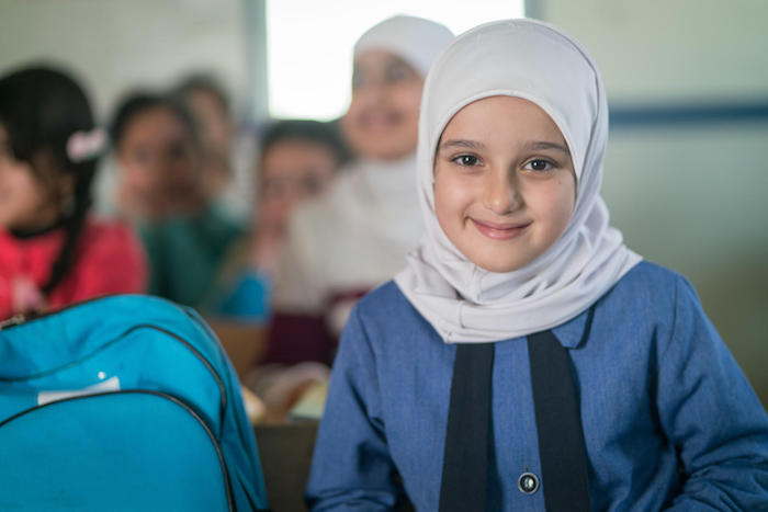 Syrian refugee Sadeen, 10, built a house out of Lego bricks at school in Za'atari Refugee Camp in Jordan. One day, she hopes to build a real house for her family.