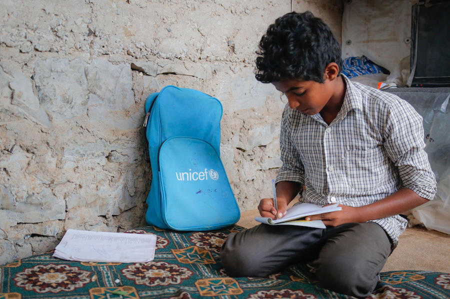 Displaced from his home in Taiz, Yemen, 12-year-old Azmi is continuing his education in Aden City, Yemen, with help from UNICEF.