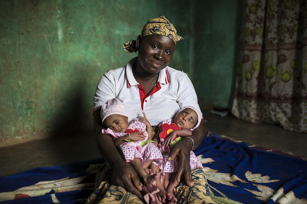 "Fatoumata of Bougouni, Mali, pictured above with newborn twin daughters Foune and Wassa, is the mother of five children, all of whom have received a full course of immunizations through a UNICEF-supported program. ""All my five children are very healthy,"""
