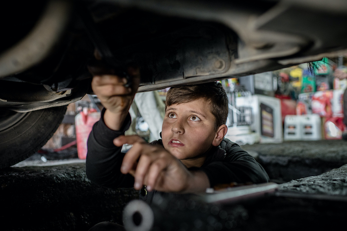 Mohammed, 14, a Syrian refugee from Kobani, works at a car repair shop in Erbil in the Kurdistan region of Iraq.
