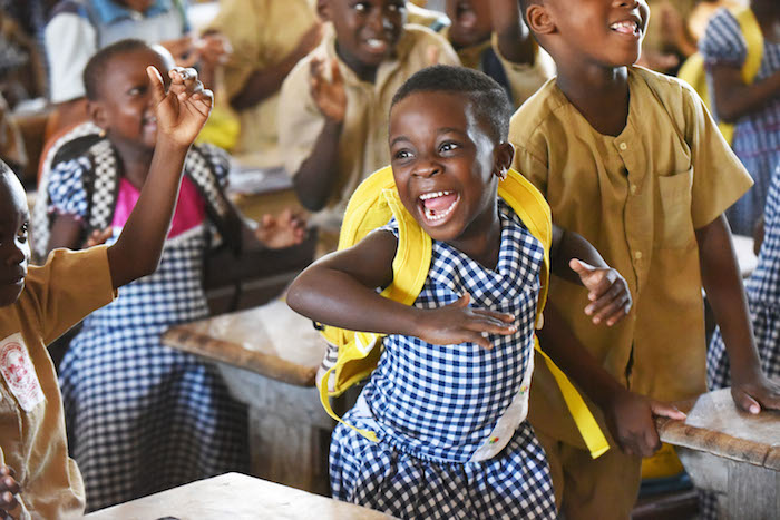 Children show their enthusiasm and friendship during class in Gonzagueville, in the South of Côte d'Ivoire.