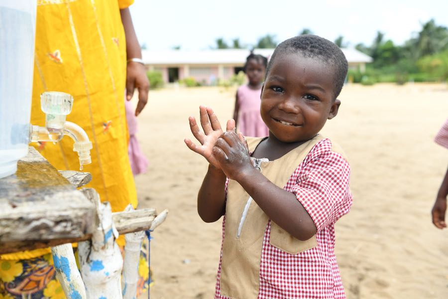 A young boy is washing his hands at school in Essankro, in the South East of Côte d'Ivoire. In Côte d'Ivoire, regular handwashing with soap and water is not common yet this simple gesture saves lives. Simply washing hands with soap and water can reduce by