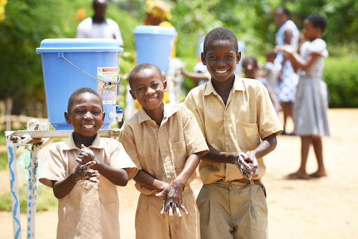 Students wash their hands at school in Essankro, in southeastern Côte d'Ivoire.
