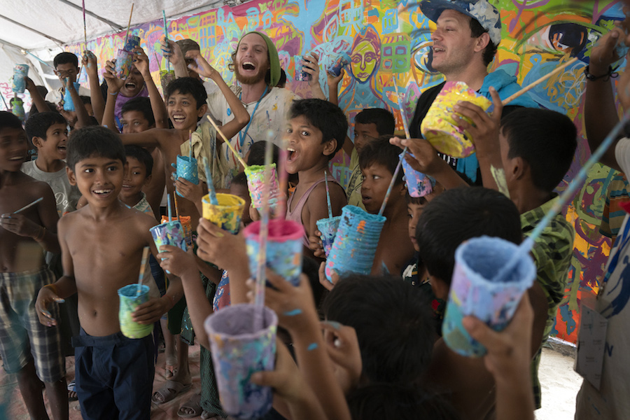 American artists volunteered with UNICEF to help Rohingya refugee children paint a mural as part of a public arts exchange.
