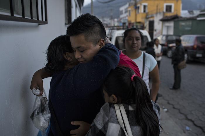 A family reunites at a government reception shelter inQuetzaltenango, Guatemala.