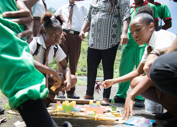 Students at Community High School in Roseau, Dominica, use building blocks to develop a disaster contingency plan for their school in the wake of Hurricane Maria, which left 90% of all school buildings on the island damaged or destroyed.