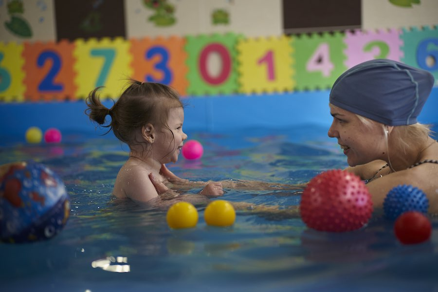 On 20 May 2018 in Belarus, three-year-old Agatha exercises during an aquatherapy session with Svetlana, a rehabilitation swim teacher, at a swimming pool with facilities for children with disabilities, in Minsk, the capital. Agatha has cerebral palsy and