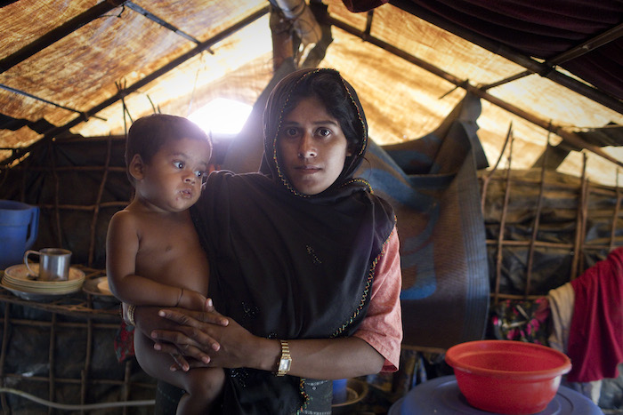 Monsoon rains are flooding homes in the Rohingya refugee camp in Bangladesh, complicating humanitarian relief efforts.