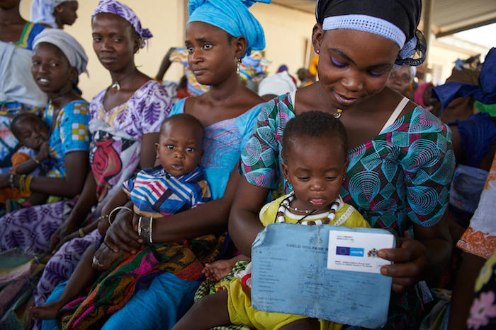 Mothers and infants who benefit from a UNICEF-supported cash transfer program in Gambia.