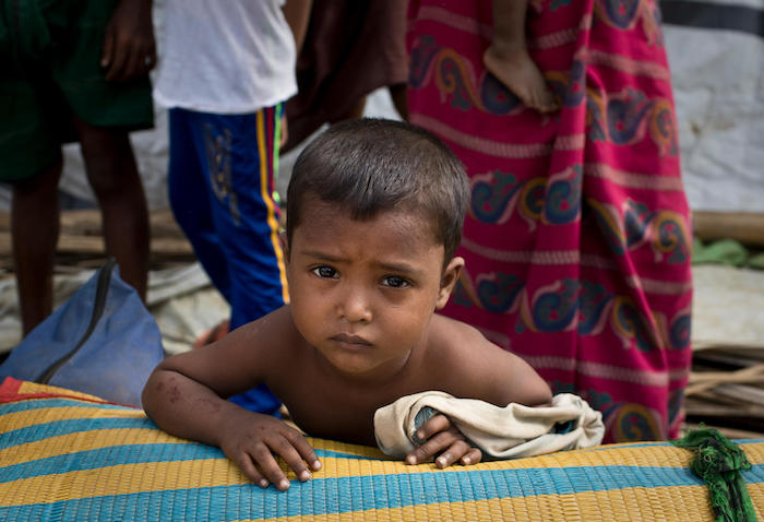 Mohammed, 4, waits with his family to be relocated to a safer landslide and flash flood-free zone of the Balukhali-Kutupalong refugee camp in Cox's Bazar, Bangladesh.