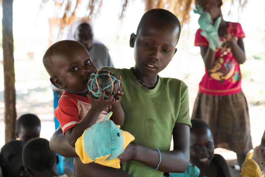 South Sudanese refugee baby playing with locally made sponge ball in Uganda's Yumbe district.