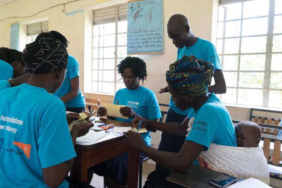 Led by UNICEF-supported instructors, caregivers make educational toys at St. John Bosco Primary Teachers College in Londonga, Uganda.
