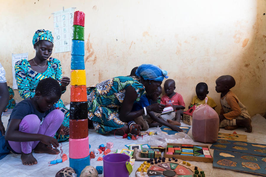 South Sudanese refugee children play with locally made toys at Bright Early Childhood Center, Yumbe District, Uganda.