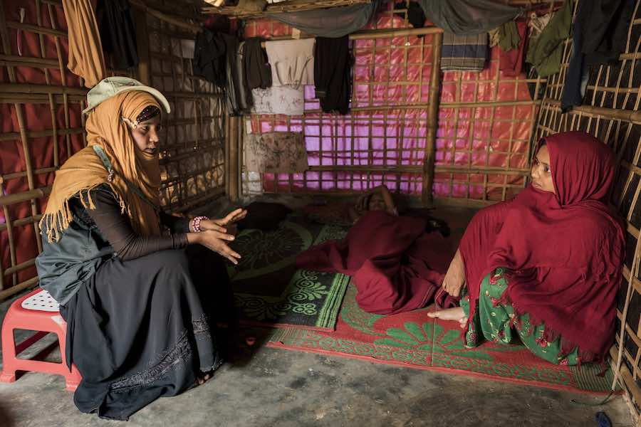Asheka Akter, 16 years old model mother wakes around the Balukhali refugee camp, advising families mainly mothers how to care and keep their home clean. Askeka arrived in Bangladesh in September last year. She enjoys the challenge of working as a model mo