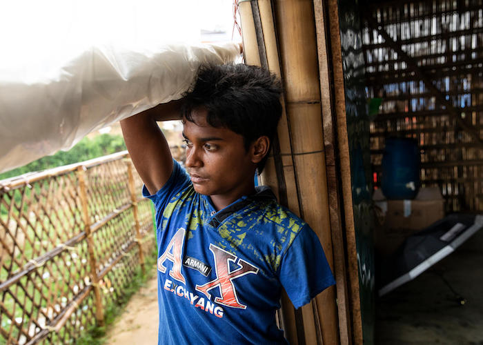 13-year-old Rohingya refugee Mohamed's arm was shot off as he ran away from his village in Myanmar, where houses were being burned down. He now lives in Chakmarkul refugee camp in Bangladesh.