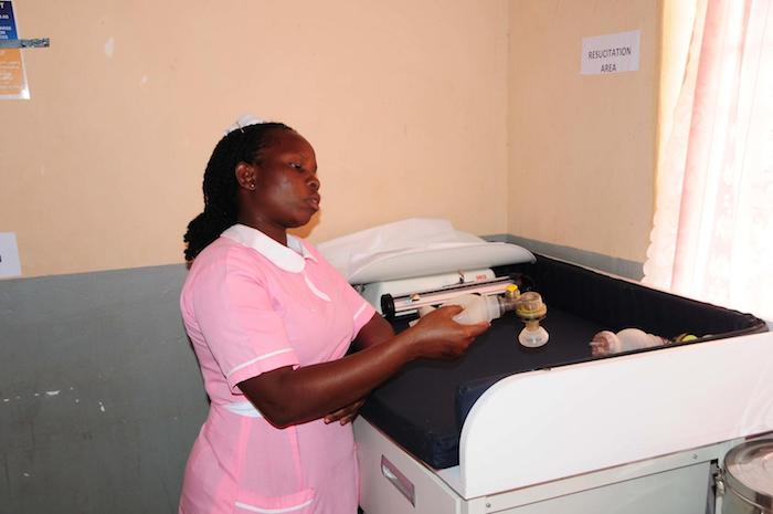 Midwife Betty Ipoot displays a newborn resuscitation kit in Apeitolin Health Center II in Uganda's Napak district.