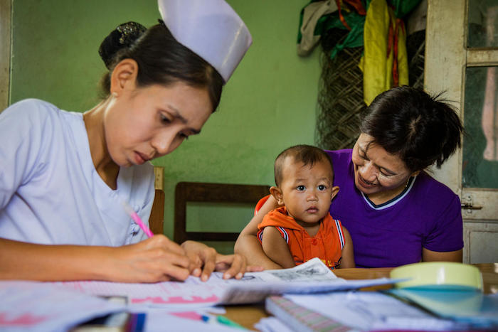 A nurse registers a baby as part of the National Birth Registration Campaign in Naypyitaw, Myanmar on June 4, 2018.