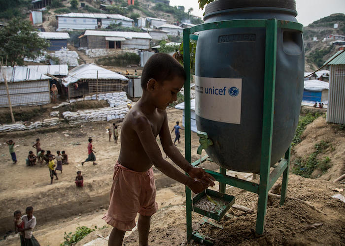 A Rohingya boy washes his hands at a UNICEF water point in Unchiprang refugee camp, Cox's Bazar district, Bangladesh.