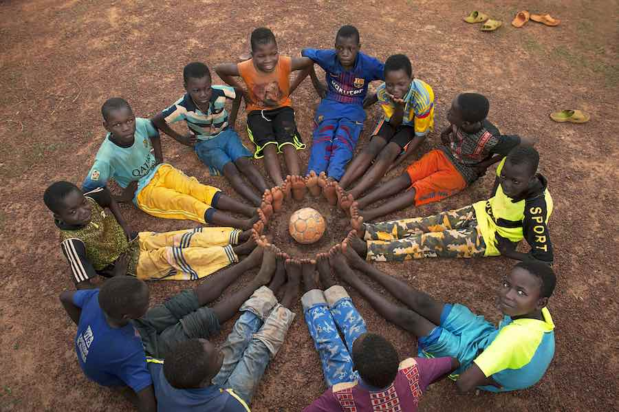 Education is vital for every child to flourish in life, especially in conflict effected areas, where children need help learning how to read and form the connections that make for peaceful environments. Above, a group of boys take a time out from their so