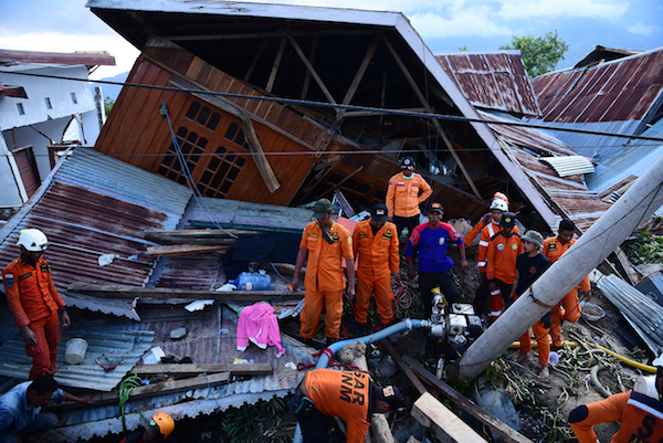 On 30 September 2018 in Indonesia, Basarnas evacuates earthquake victims at the Balaroa National Park, West Palu, Central Sulawesi, after the earthquake and tsunami that struck Sulawesi on September 28.