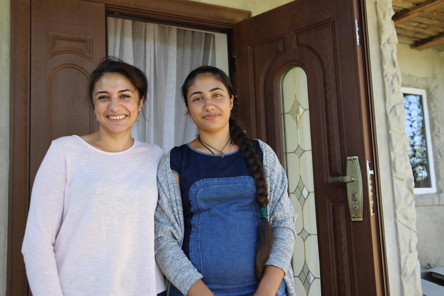 In the village of Vulcanesti, Republic of Moldova in September 2018, Renata, 14 (right), stands with her older sister, Randunica, 24, who married at 17 and advises her younger sister to stay in school.