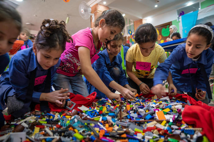 Playing with LEGOs is fun and educational for Syrian children living in a refugee camp in Jordan.