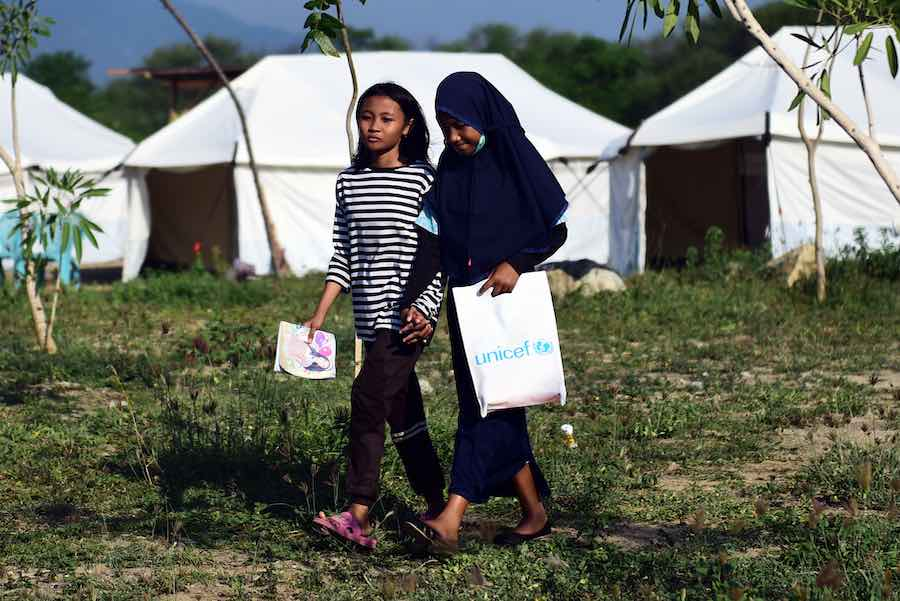 Sophia Angelica Majid, 11, (above left) went to school with just one exercise book and one pen in the early days after 7.4 magnitude earthquake and tsunami devastated her home and school in Central Sulawesi, Indonesia.