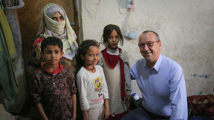 UNICEF Regional Director for Middle East and North Africa Geert Cappalaere visits a family benefiting from the Emergency Cash Transfer program in Sana'a, Yemen in October 2018.