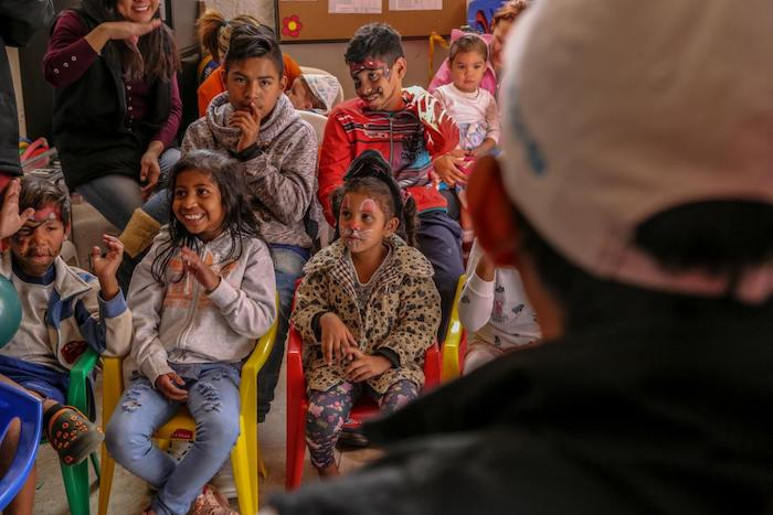 Children learn about the importance of handwashing with soap at a UNICEF-supported Child Friendly Space in Ecuador.