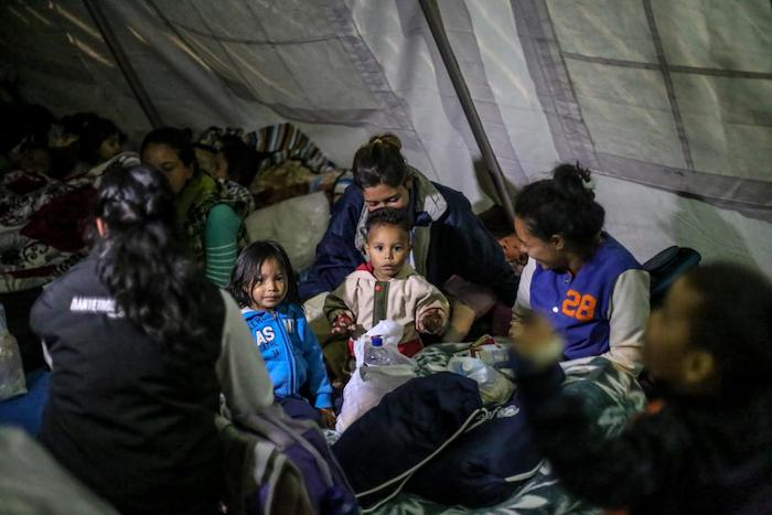 Migrant children and mothers gather at a UNICEF temporary rest tent in Rumichaca, Ecuador on the border with Colombia.