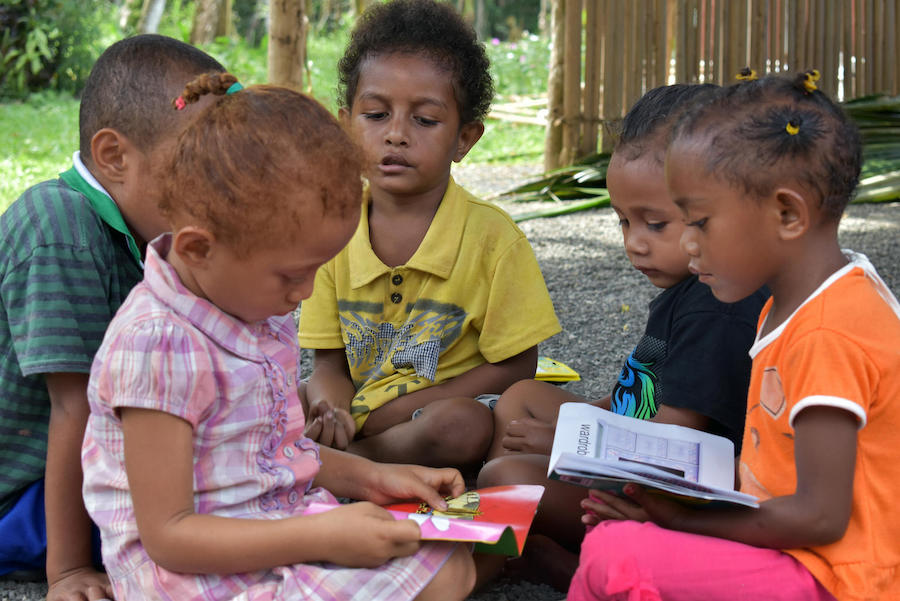 In July 2018, a group of young preschoolers read at Ladava Early Learning Center, supported by UNICEF, in Alotau, Milne Bay Province, Papua New Guinea.