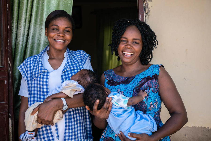 In November 2018, community health worker Amilia Mathew (left) and her sister hold twins born at the UNICEF-supported clinic, Nana As'mau, in Yola, Nigeria.