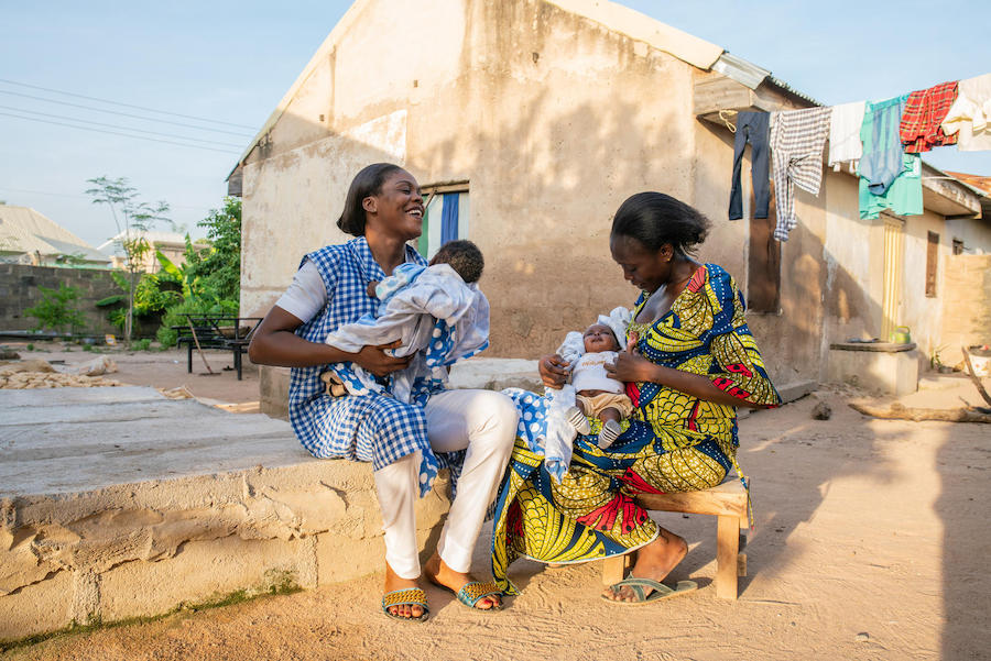 Community health worker Amilia Mathew (left) visits a new mother who recently delivered twins in the UNICEF-supported Nana As'mau clinic in Yola, Nigeria.
