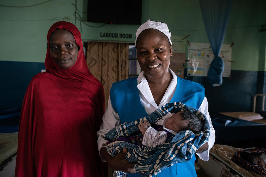 UNICEF-trained midwife Rahama Kadafa (right) safely delivered Hajara Umar's baby daughter, Harira at Nana As'mau clinic in Yola, Nigeria in October 2018.
