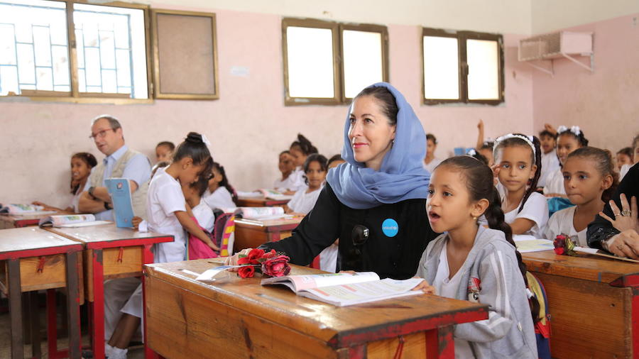 At the Ibn Zaidoon School in Aden, Yemen, girls attend class with UNICEF Regional Director for Middle East and North Africa Geert Cappelaere (adult on left) and UNICEF Representative in Yemen Merixell Relano (adult on right).