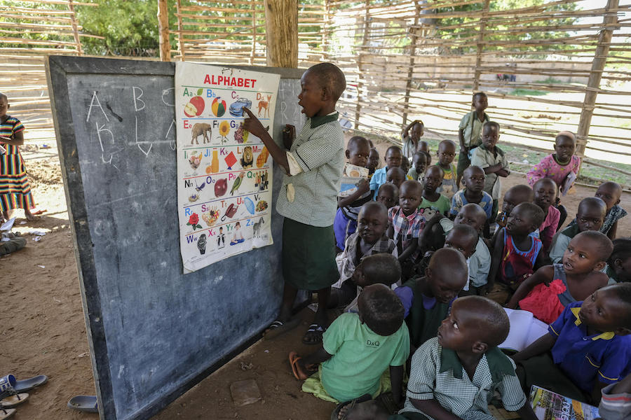 A child recites the English alphabet to a group of his 3- and 4-year-old peers in one of the classrooms of the picturesque Rock City School in Juba, South Sudan.