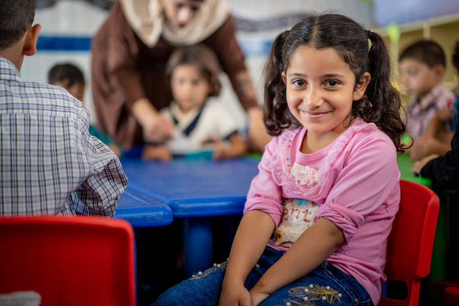 "The first generation of children born in Za'atari Refugee Camp have started school.   ""They are the same as children all over the world,"" says the Kindergarten teacher. ""They need to be prepared for school. Preschool is important for their well being."""