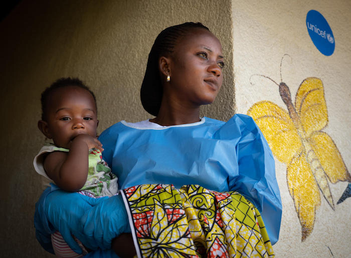 Jemima, an Ebola survivor, cares for 6-month-old Josué at a UNICEF-supported child care center in Beni, Democratic Republic of the Congo, in December 2018.