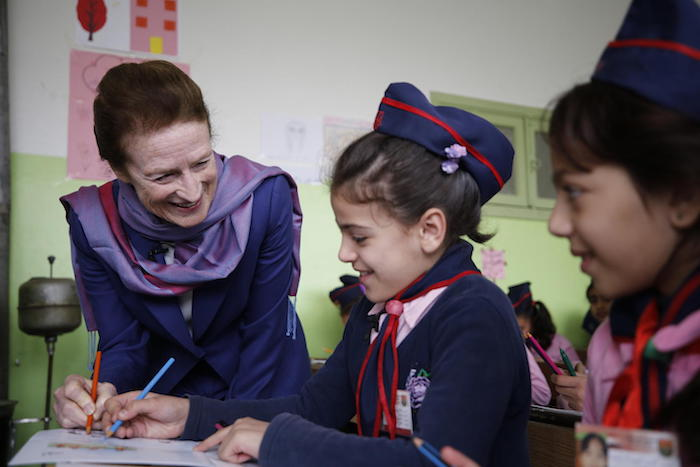 In December 2018, UNICEF Executive Director Henrietta H. Fore (left) chats with children at a Mine Risk Education class at Al-Mahatta Al-Awla primary school in Izra city, in Dara'a, southern Syria.