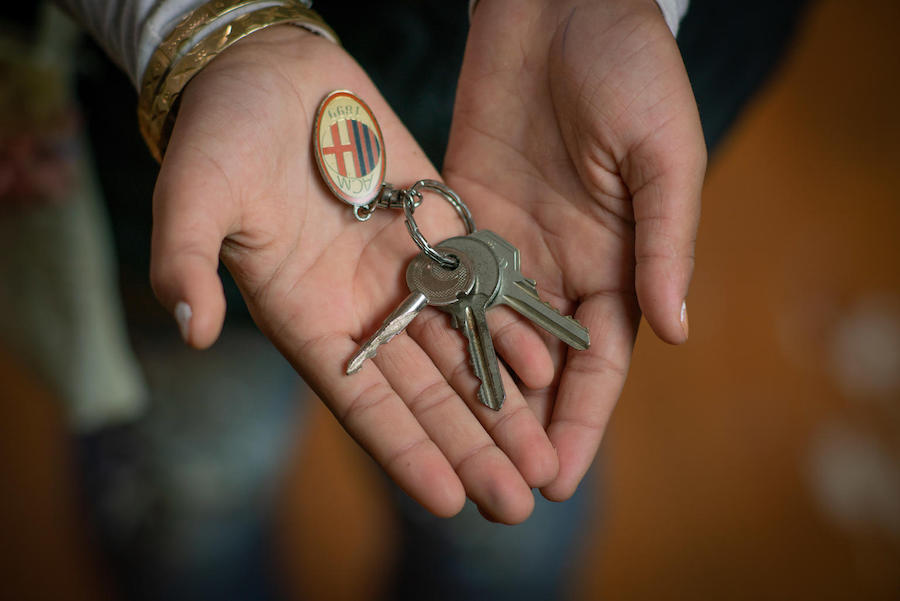 In Jordan's Za'atari Refugee Camp, Rudaina, 11, holds the keys to her old house in Syria.