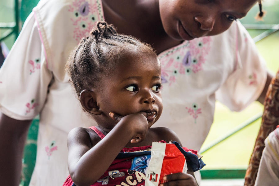A baby girl eats Ready-to-Use Therapeutic Food provided by UNICEF and partners at a health center in Kananga, Kasai-Occidental province, Democratic Republic of the Congo, in October 2018.