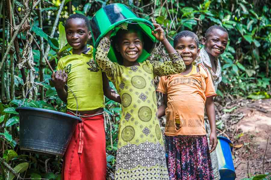 Children clown around while collecting water at a pumping and water distribution station near Kananga,Kasai-Occidental province, Democratic Republic of Congo (DRC), 25 October 2018. UNICEF built this particular station as part of its allotment of US$109 m