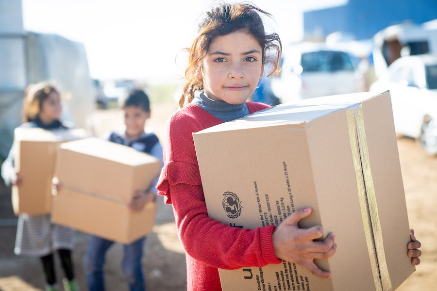 Reem, 10 years, holds her winter clothing kit. She has five sisters and two brothers – between 2 and 15 years. Her family are Syrian refugees and came to Jordan six years ago. She has just received her winter clothing kit from UNICEF and its partner Matee