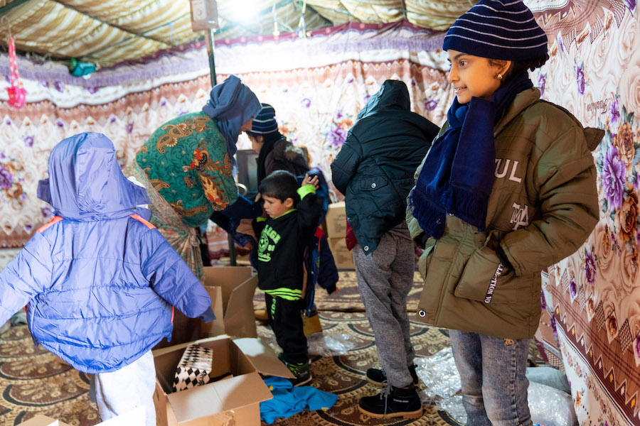 """""""When I saw the winter clothes I was very happy because for a very long time we didn't have any,"""" says, Muna, one of 3,800 Syrian children facing a tough winter. """"It gets cold at night and it's really tough. My parents can't always afford the gas."""""""