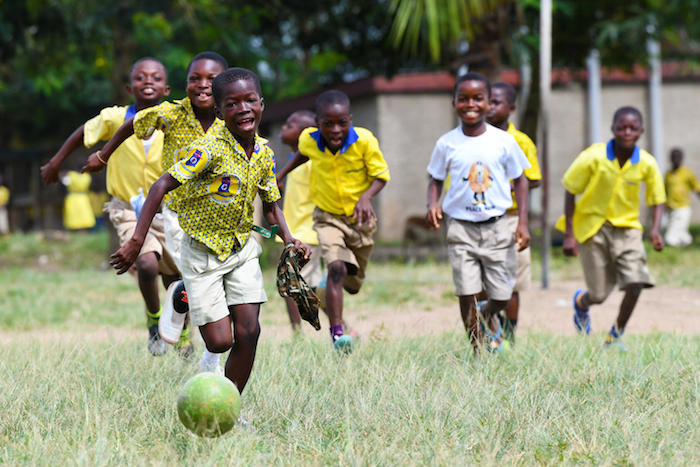 Boys playing football outside the Asuokaw Methodist School in eastern Ghana.
