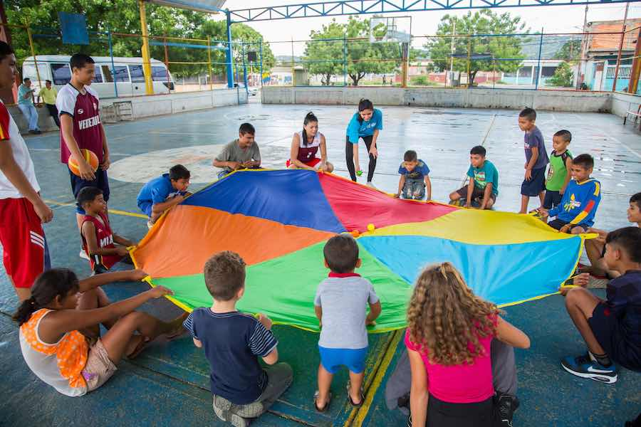 UNICEF Venezuela staff with children at one of the UNICEF Child Friendly Spaces has opened since 2018 to help children find relief from the violence and deprivation of their communities. In these friendly and welcoming environments, children and adolescen