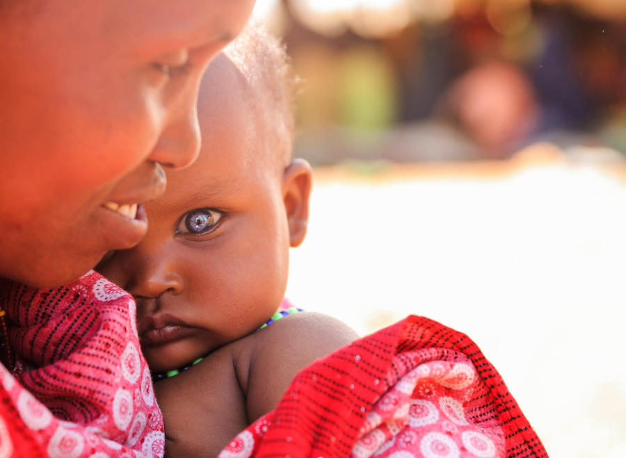 A mother of seven, 35-year-old Habiba Biyow Roba holds her 8-month-old daughter, Sumeya, at the UNICEF-supported Berak camp for internally displaced persons in Ethiopia's Oromia Region.