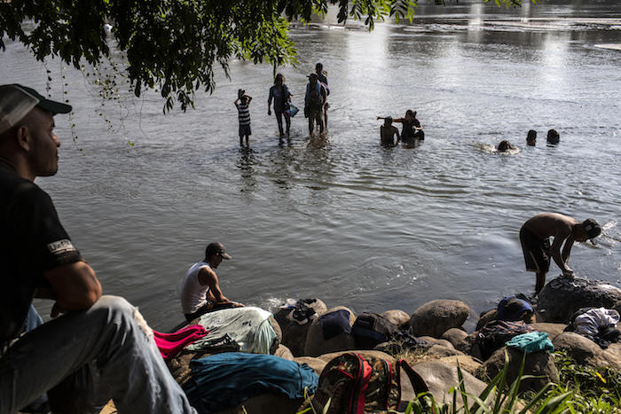 Migrant families wash clothes in the Suchiate River at the Mexico-Guatemala border in Ciudad Hidalgo, Mexico, on January 31, 2019.