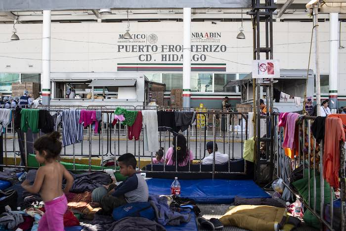 Migrant families wait for fast-track humanitarian visas at the Mexico-Guatemala border in Ciudad Hidalgo, Mexico, on January 31, 2019. The one-year visa allows migrants to stay in Mexico, work and access social services.